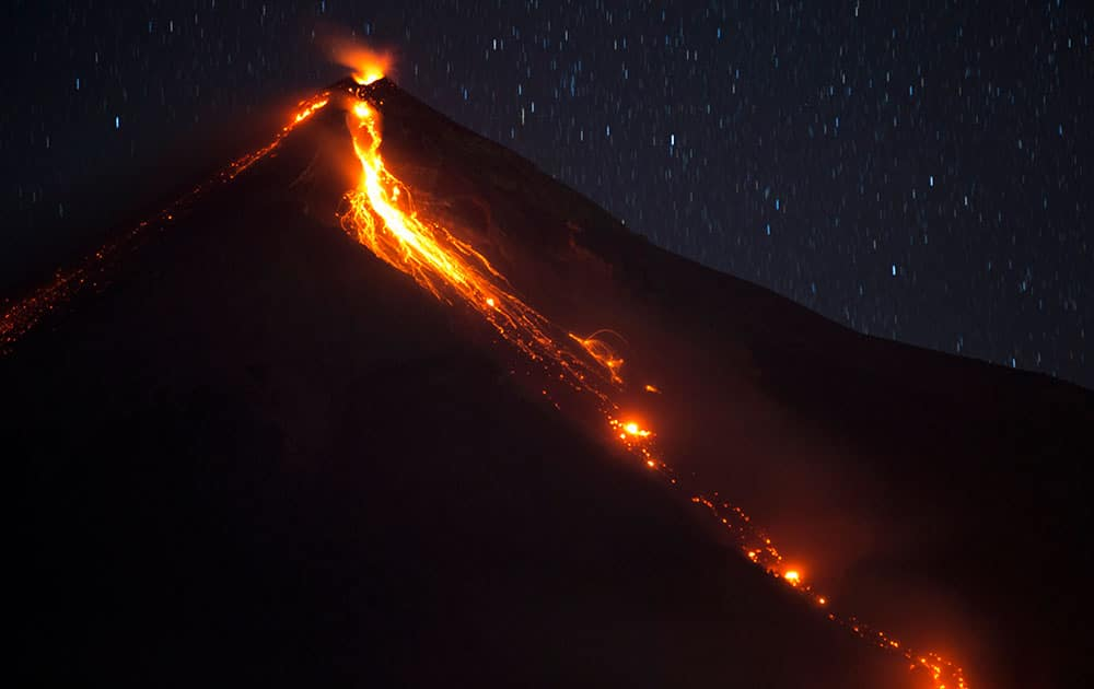 The Volcano of Fire releases lava, seen from Escuintla, Guatemala.