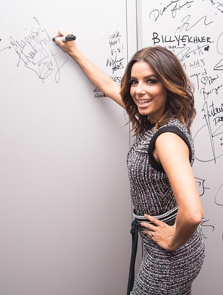 Actress Eva Longoria signs the wall at AOL Studios after participating in AOL's BUILD Speaker Series to discuss her new NBC comedy