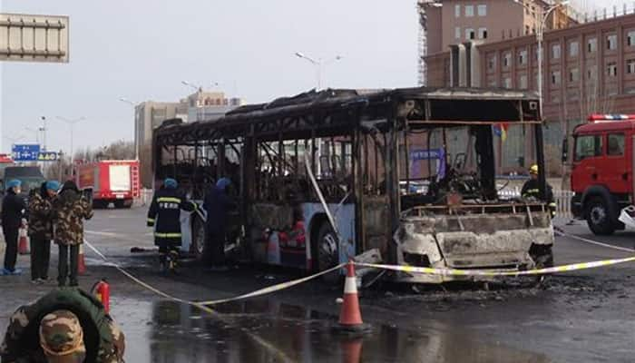 China bus arson suspect threatened violence: Media