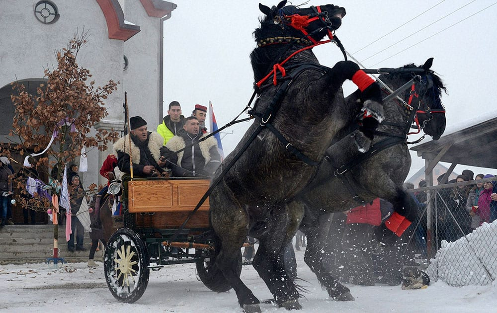 Bosnian Serb men ride horses as they prepare for a traditional parade for the Orthodox Christmas Eve, in the village of Glamocani near Bosnian town of Banja Luka, 350 km northwest of Sarajevo.