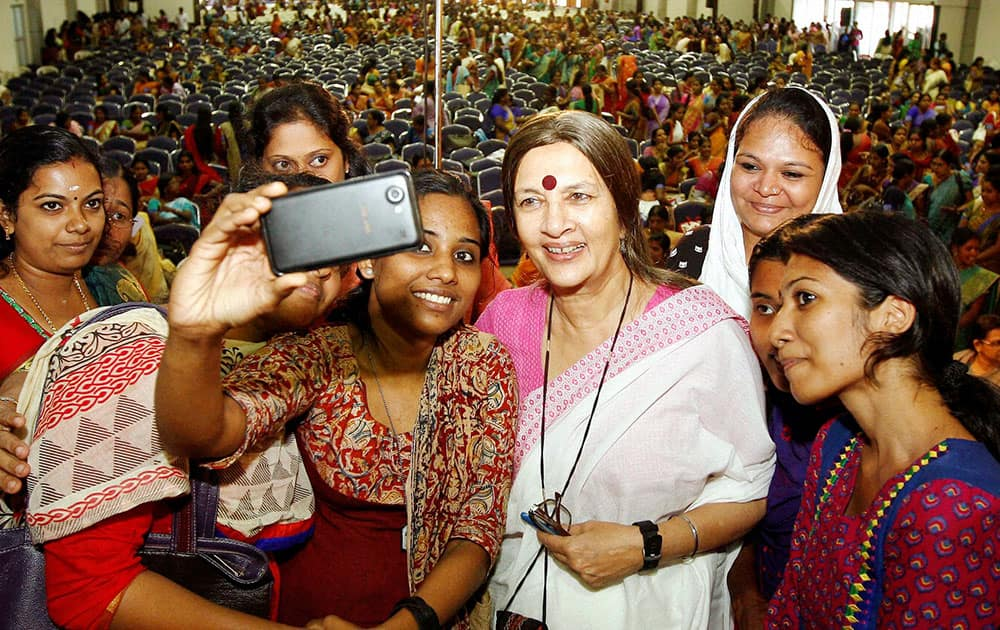 CPM politburo member Brinda Karat takes selfie with participants as she arrives for the inauguration of the Women's Parliament function in Kochi.