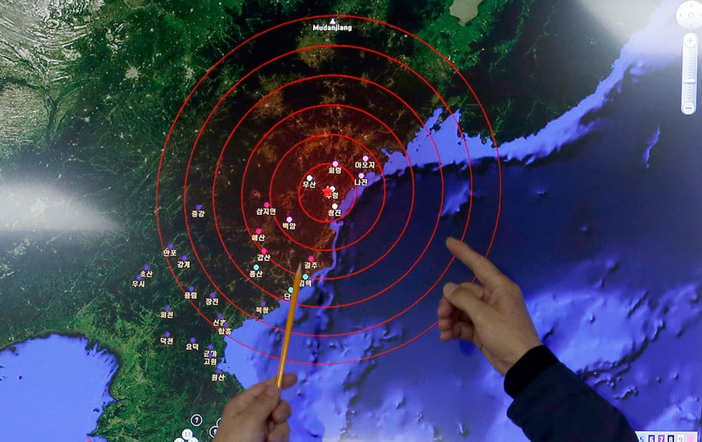 Officers from the Korea Meteorological Administration point at the epicenter of seismic waves in North Korea, at the National Earthquake and Volcano Center of the Korea Meteorological Administration in Seoul, South Korea.