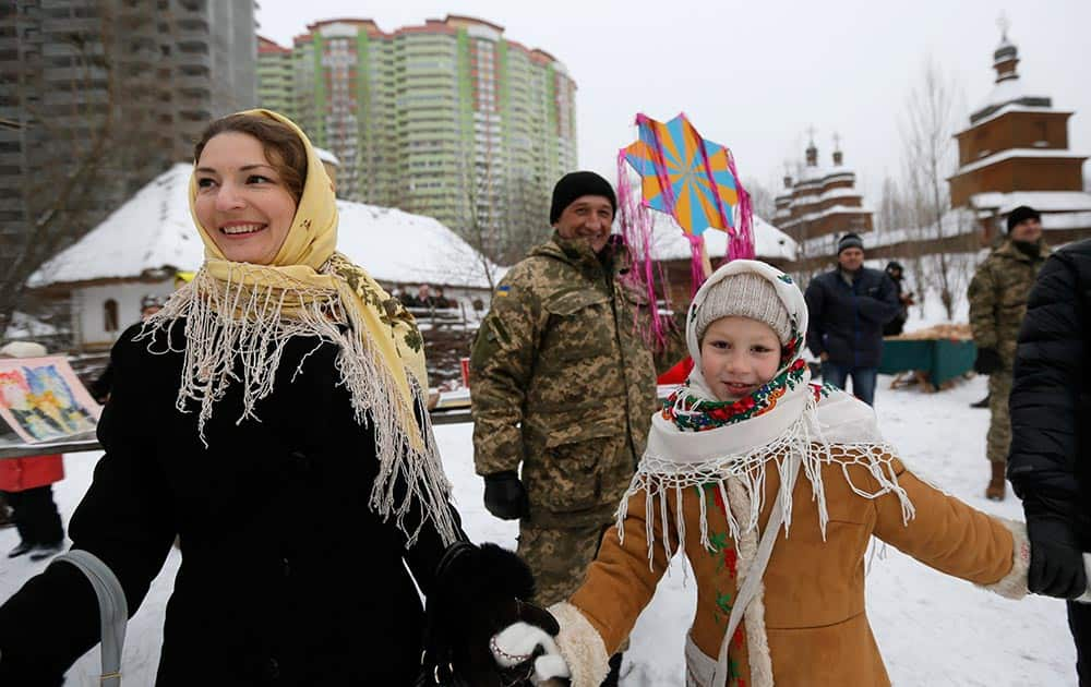 Ukrainians celebrate Orthodox Christmas in Kiev, Ukraine, Thursday, Jan. 7 2016. Orthodox Christians mark their traditional Christmas Day Jan. 7, with many ancient symbolic events.