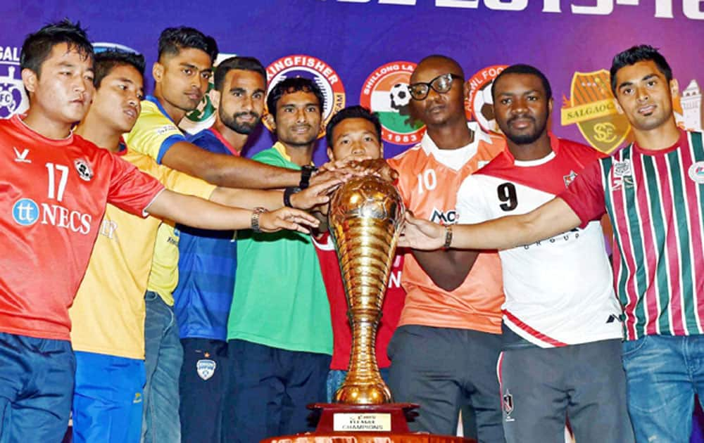 Captains of all nine clubs pose with the official trophy at the launch ceremony of I-League 2016 in Kolkata.