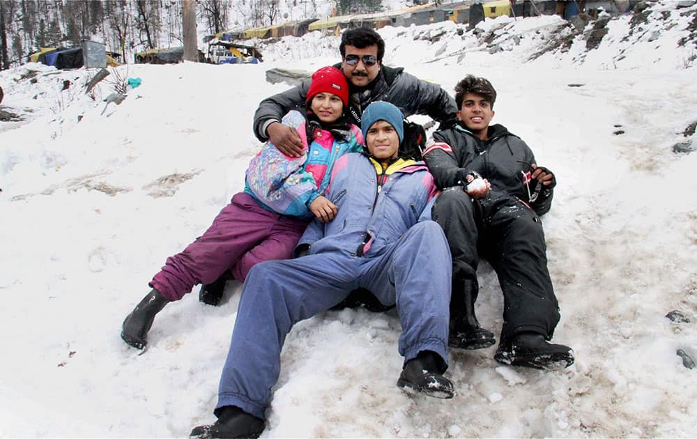 Manali: Tourists enjoying in the snow draped Manali in Himachal Pradesh on Saturday following the recent fresh snowfall in the state.