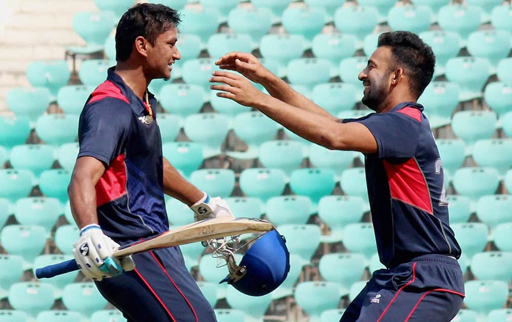 Vidarbha batsman Apoorva Wankhedel (L) celebrates with captain Faiz Fazal after winning knock against Hyderabad during Syed Mushtaq Ali T20 Trophy match at Vidarbha Cricket Association (VCA) Stadium in Nagpur.