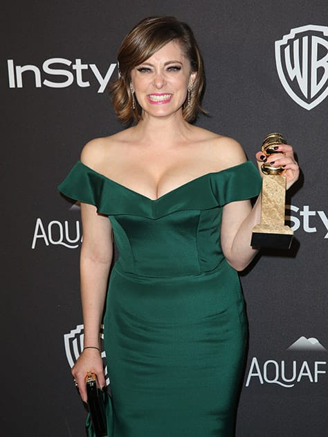 """Rachel Bloom, winner of the award for best performance by an actress in a television series - musical or comedy for """"Crazy Ex-Girlfriend"""", arrives at the InStyle and Warner Bros. Golden Globes afterparty at the Beverly Hilton Hotel in Beverly Hills, Calif."""