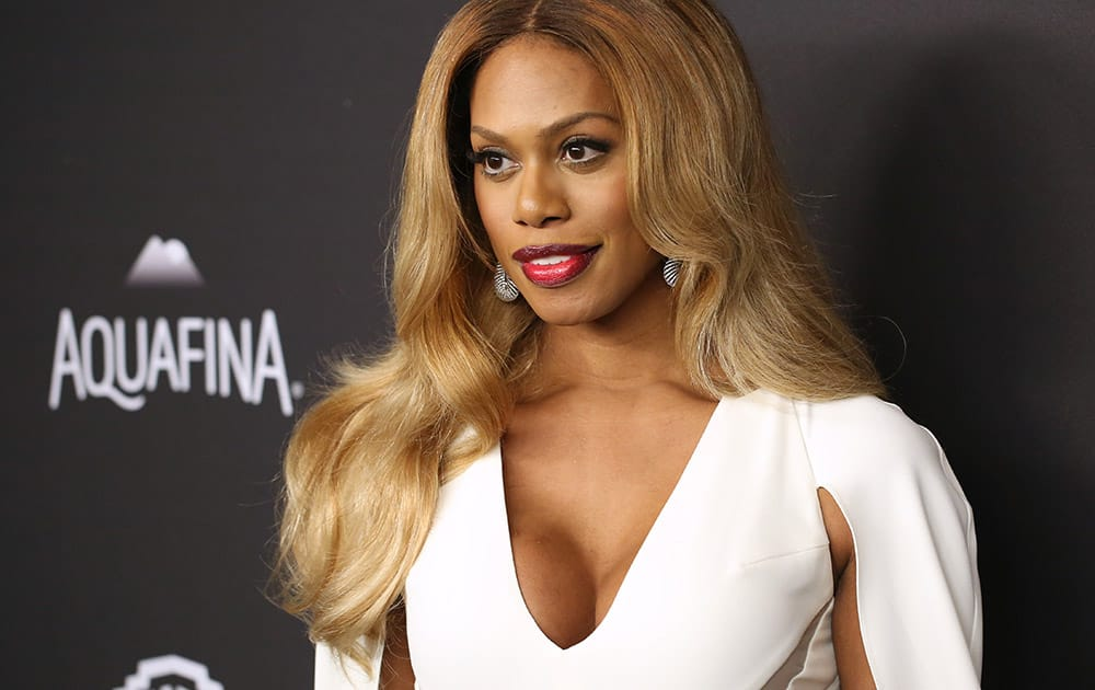 Laverne Cox arrives at the InStyle and Warner Bros. Golden Globes afterparty at the Beverly Hilton Hotel in Beverly Hills, Calif.