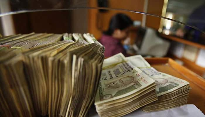 Rupee trims initial losses, still down 15 paise
