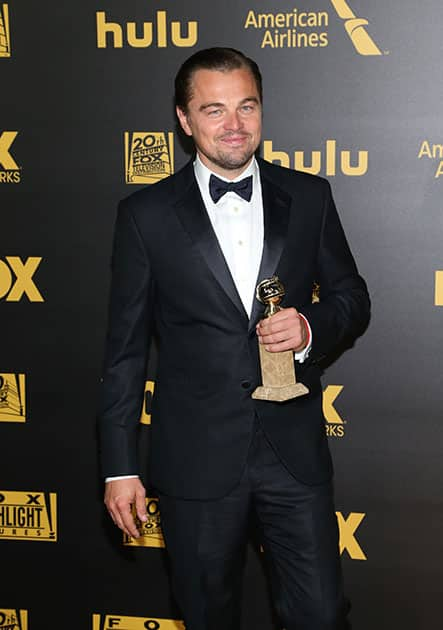 """Leonardo DiCaprio poses with the award for best performance by an actor in a motion picture - drama for """"The Revenant"""" at the FOX Golden Globes afterparty at the Beverly Hilton Hotel in Beverly Hills, Calif."""