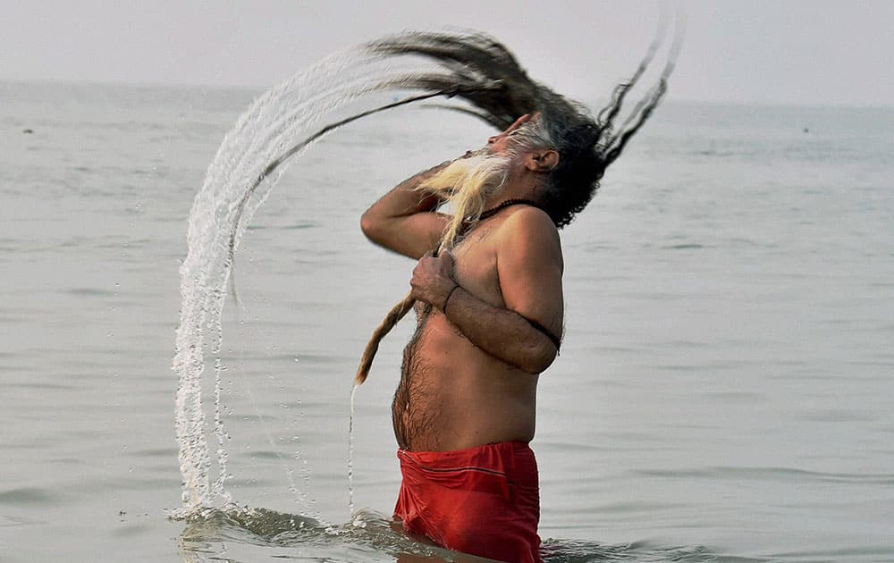 A sadhu takes a holy dip at Gangasagar, the confluence of River Ganga and Bay of Bengal on the occasion of Makarsankranti.