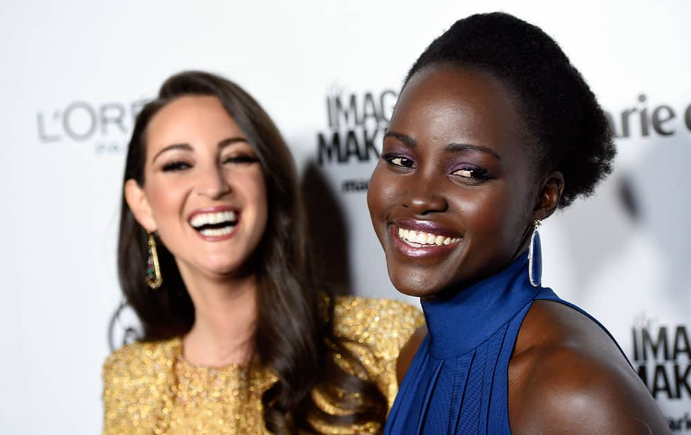 Choice Stylist honoree Micaela Erlanger, left, and actress Lupita Nyong'o share a laugh as they pose together at the Marie Claire Image Maker Awards at the Chateau Marmont in Los Angeles.