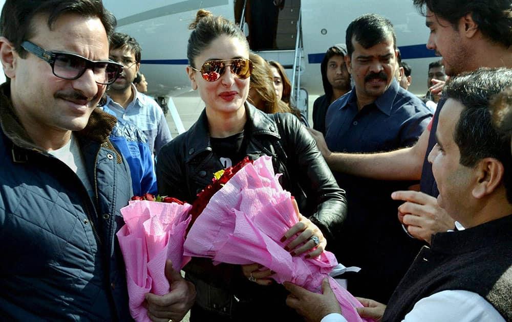 Samajwadi Party MP Dharmendra Yadav receives actor-couple Saif Ali Khan and Kareena for Saifai Mahotsav in Saifai.