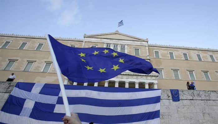 EU warns Greece not to 'play games' with IMF