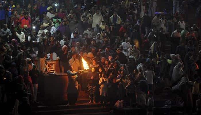 Devotees take first holy dip of Ardh Kumbh in Haridwar