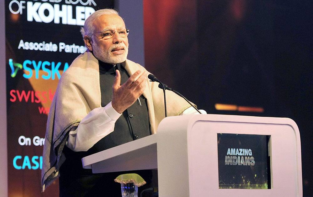Prime Minister Narendra Modi addresses during the presentation ceremony, in New Delhi.