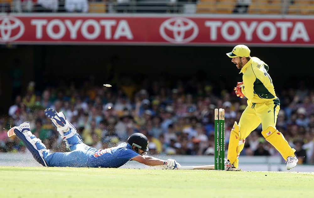 Virat Kohli, left, is run out by Australia's Matthew Wade, right, during the 2nd One Day International cricket match between Australia and India in Brisbane, Australia.