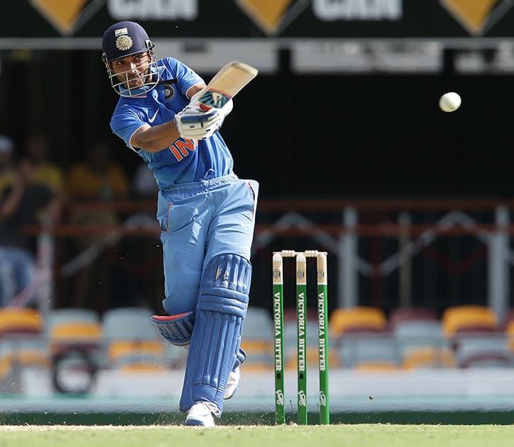 Ajinkya Rahane plays a shot during the 2nd One Day International cricket match between Australia and India in Brisbane, Australia.