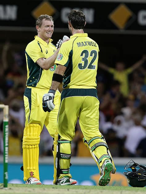 George Bailey celebrates with Glen Maxwell after they defeated India during the 2nd One Day International cricket match in Brisbane, Australia.