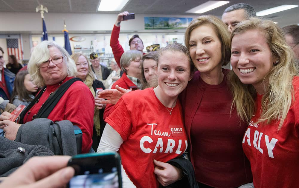 Republican presidential candidate, businesswoman Carly Fiorina has a selfie taken with supporters during a campaign stop at Hollis Pharmacy, in Hollis, N.H.