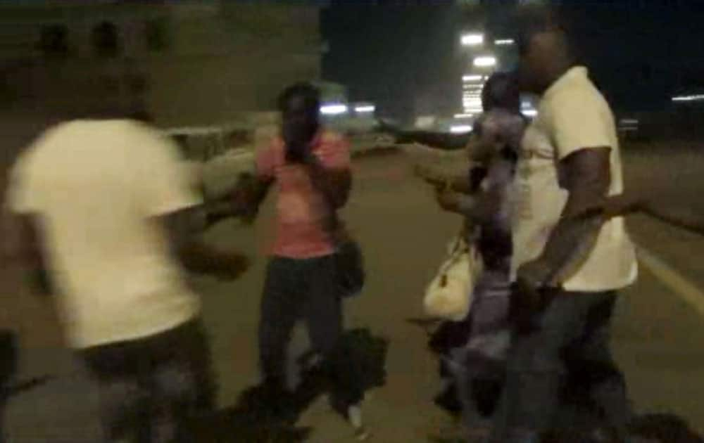 PLAIN-CLOTHED POLICEMEN LEADS PEOPLE AWAY NEAR THE SPLENDID HOTEL IN OUAGADOUGOU, BURKINA FASO. THE SITE INTELLIGENCE GROUP REPORTS THAT AN AL-QAIDA AFFILIATE IS CLAIMING RESPONSIBILITY FOR THE ONGOING SIEGE ON AN UPSCALE HOTEL AND CAFE IN BURKINA FASO'S CAPITAL WHERE AN UNKNOWN NUMBER OF HOSTAGES ARE BEING HELD.