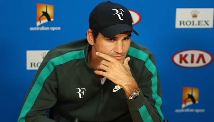 Australian Open: Roger Federer gives defending champion Novak Djokovic 'little star' of approval