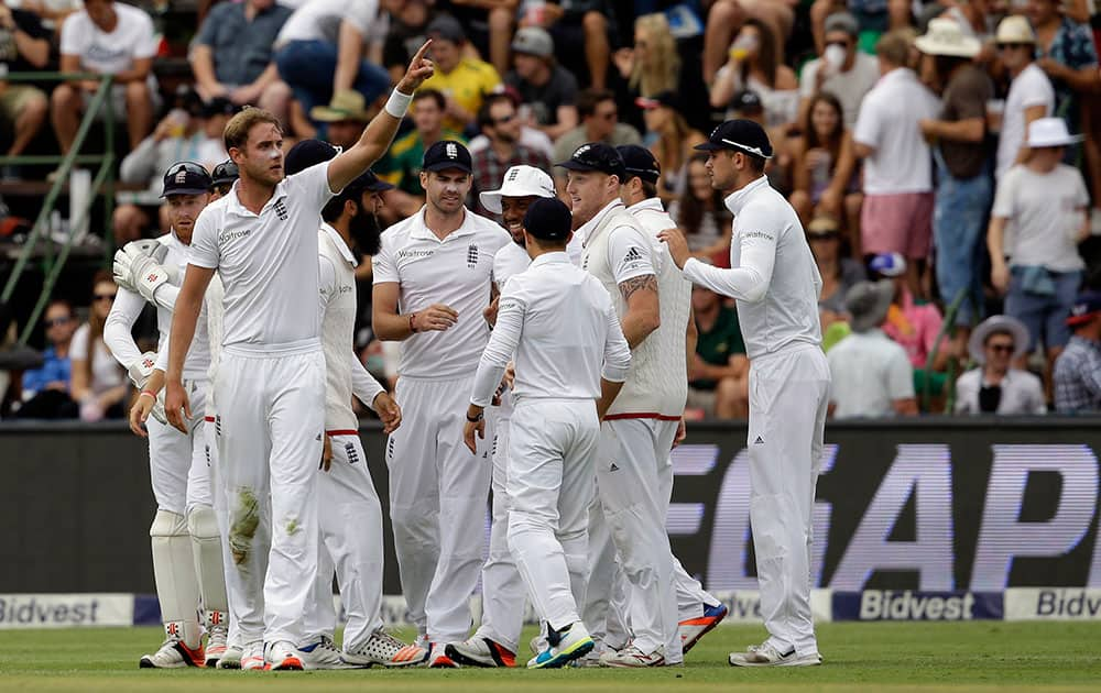 England's bowler Stuart Broad, left, gestures after taking a second wicket, that of South Africa's batsman Stiaan van Zyl, on the third day of the third test cricket match between South Africa and England, at Wanderers stadium in Johannesburg, South Africa.