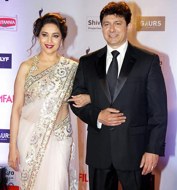 Bollywood actor Madhuri Dixit Nene with her husband Sriram Nene during the 61st Britannia Filmfare Awards function.