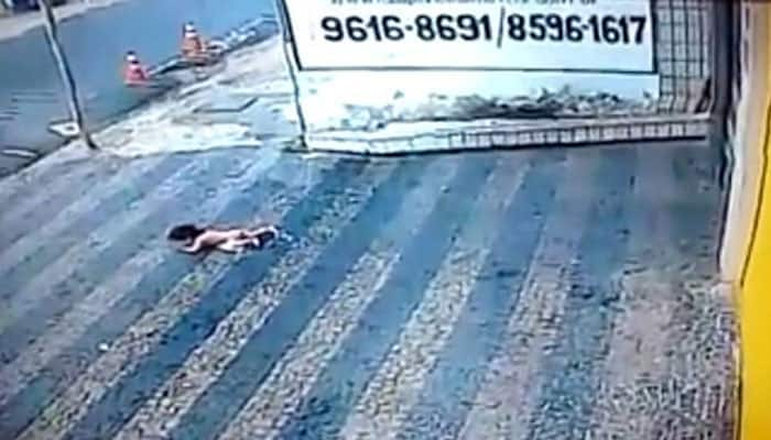 14-month-old baby survives horror fall from second floor, video goes viral - Watch