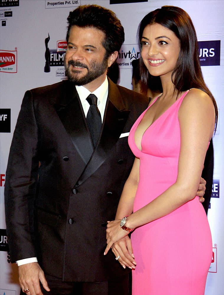 Bollywood actors Anil Kapoor and Kajal Aggarwal during the 61st Britannia Filmfare Awards function in Mumbai.