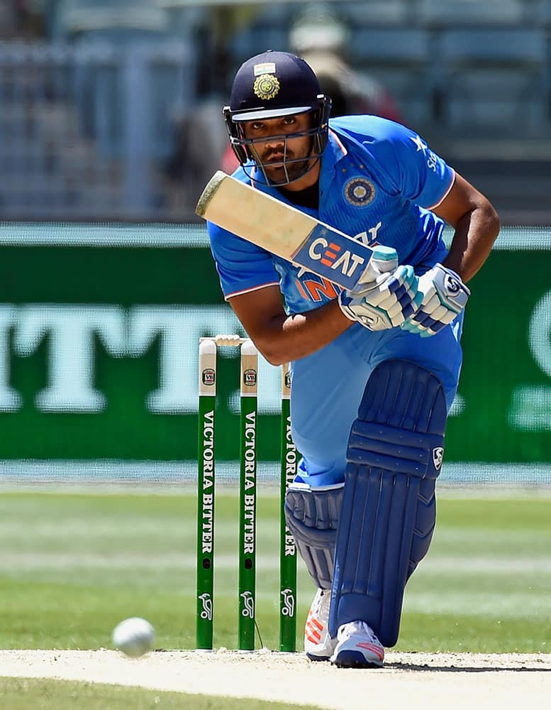India's Rohit Sharma bats against Australia during their one day international cricket match in Melbourne, Australia.