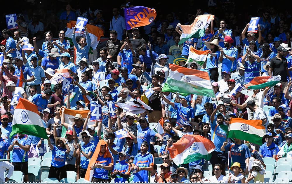 Indian fans cheer their team during their one day international cricket match against Australia in Melbourne, Australia.