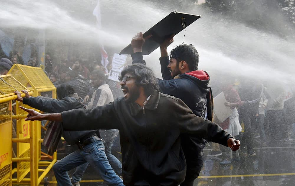 Police use water cannons to disperse students during a protest against the Ministry of Human Resource Development in New Delhi.