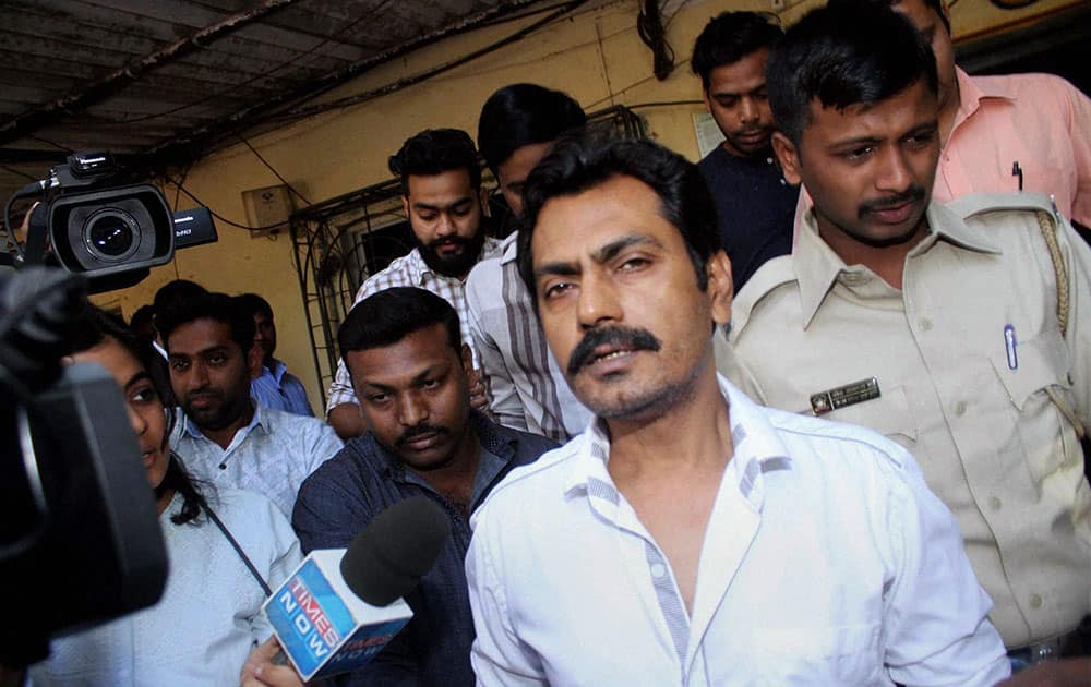 Actor Nawazuddin Siddiqui speaks with media persons at Versova Police Station in Mumbai.
