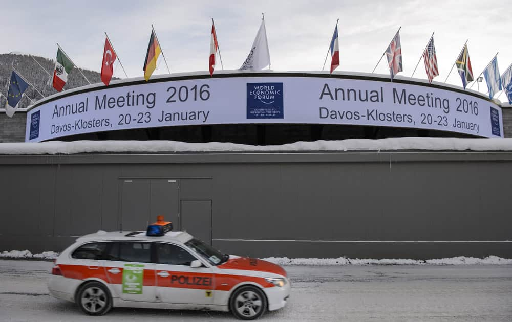 A police car passes the congress center before the opening of the Annual Meeting of the World Economic Forum, WEF, in Davos.