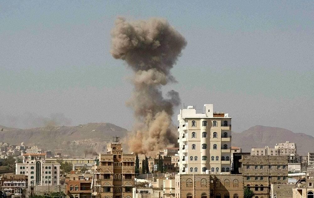 Smoke rises after a Saudi-led airstrike hit an army base in Sanaa, Yemen.