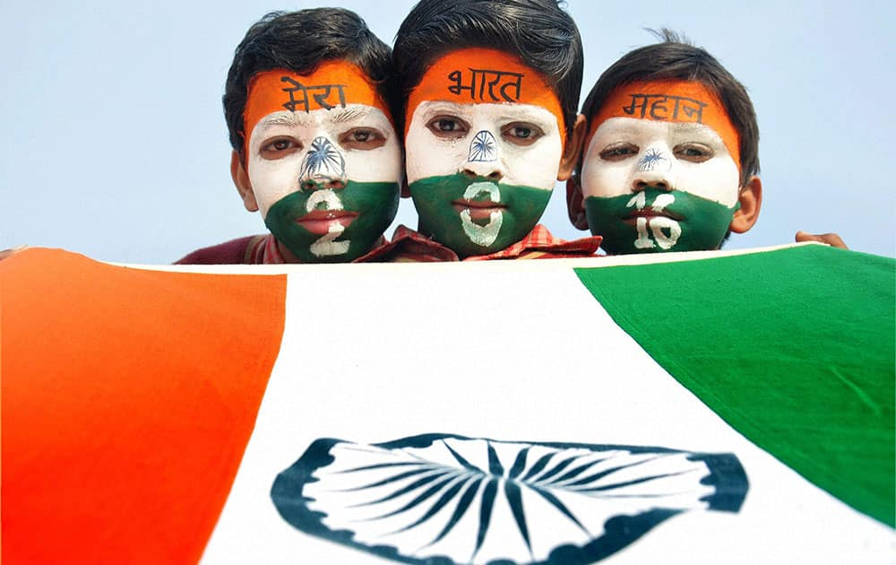 Children paint their faces with tri-colour ahead of Republic Day festival in Moradabad.