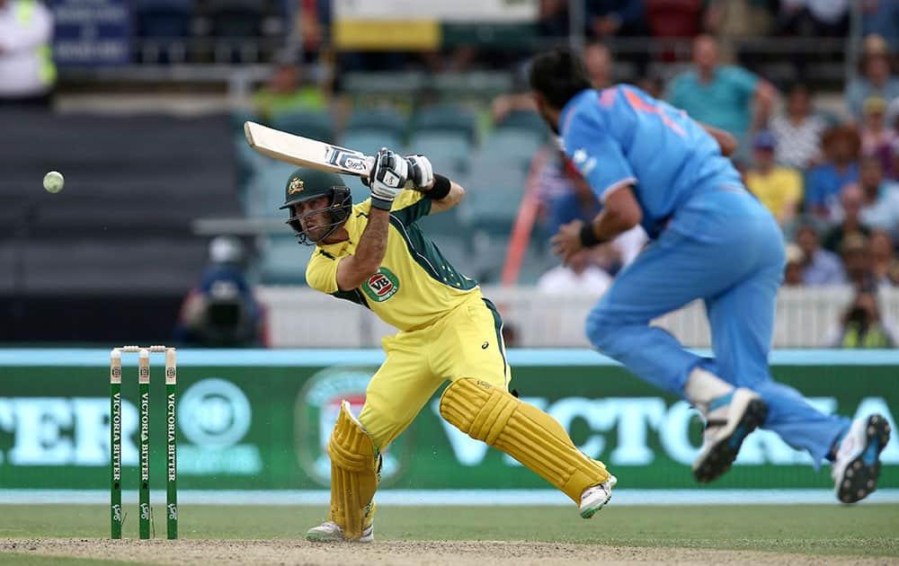 Glenn Maxwell plays a shot as India's Ishant Sharma runs in during their One Day International cricket match in Canberra, Australia.