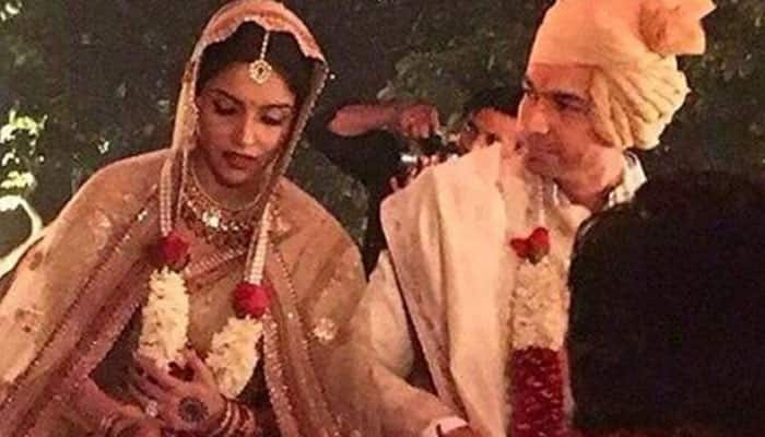 Asin-Rahul Sharma wedding: Best Man Akshay Kumar strikes a pose with bride, groom