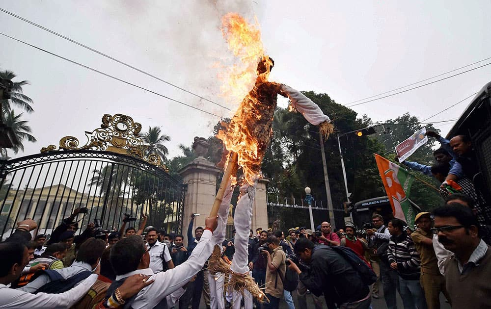Youth Congress activists burn the effigy of Union Labour and Empolyment Minister Bandaru Dattatreya in front of Governor House in Kolkata on Wednesday during a protest over the suicide by dalit student Rohith Vemula.