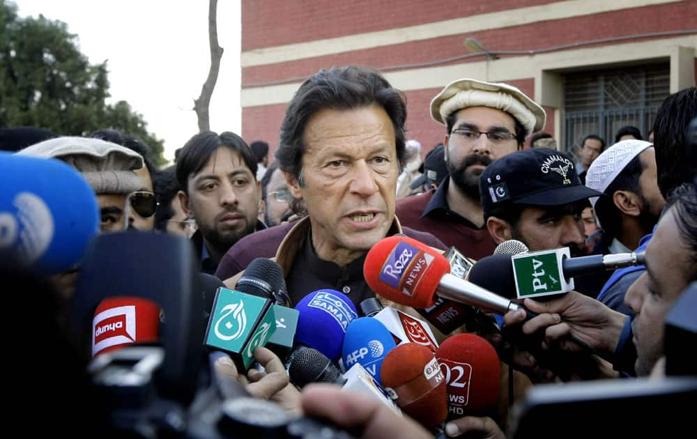 Pakistani cricketer-turned-politician talks to reporters at the Bacha Khan University in Charsadda town near Peshawar.