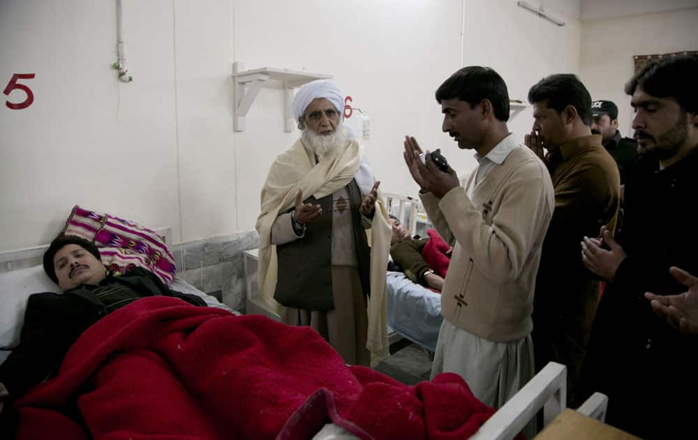 Pakistan villagers pray for the recovery of people injured in an attack on a university, at a local hospital in Charsadda town.