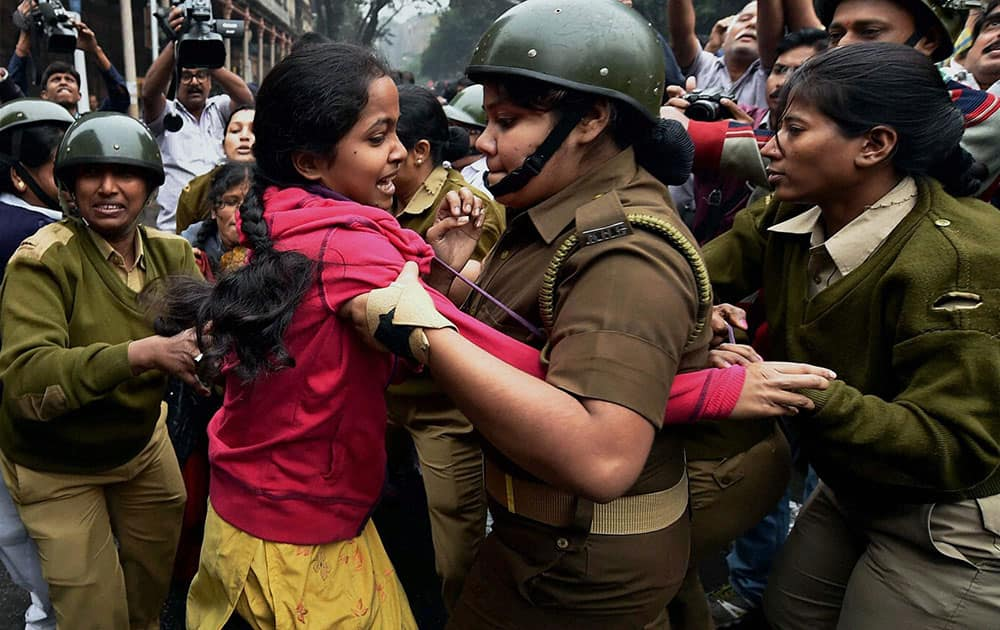 Police detain DSO (Students wing of SUCI) activists who were holding a protest against the Ministry of Human Resource Development in front of Governor House in Kolkata.