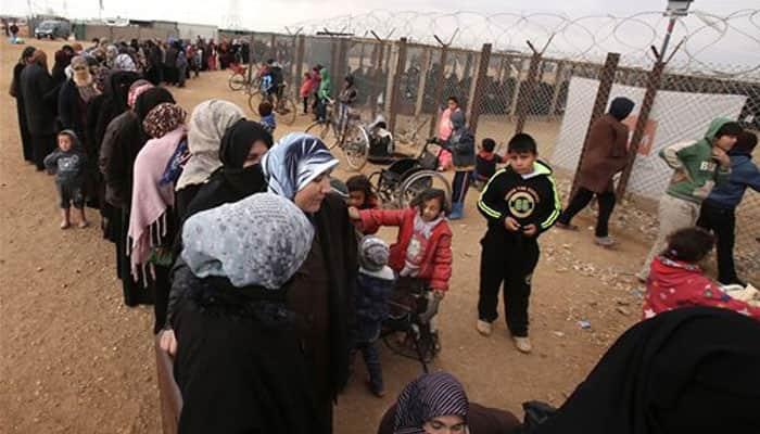 Cash aid for Jordan`s refugees an iris scan away