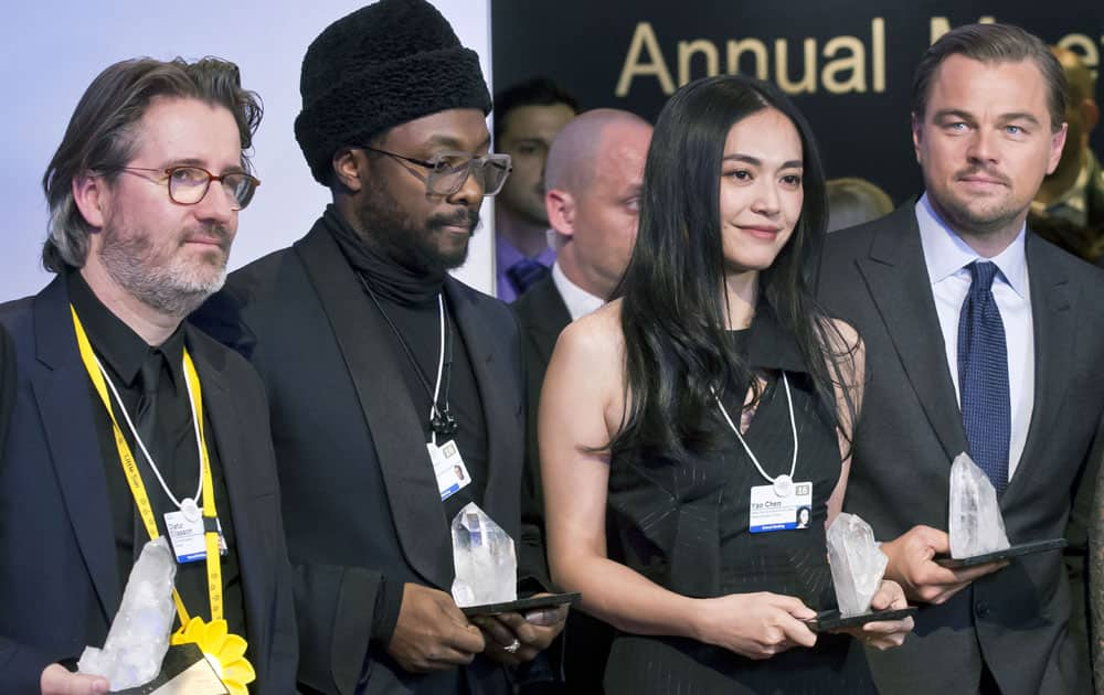 From left, Danish artist Olafur Eliasson, US singer, songwriter and rapper William Adams, Chinese actress Yao Chen and US Actor Leonardo DiCaprio pose for the media with their trophies after the Crystal Awards ceremony at the 2016 World Economic Forum in Davos, Switzerland.