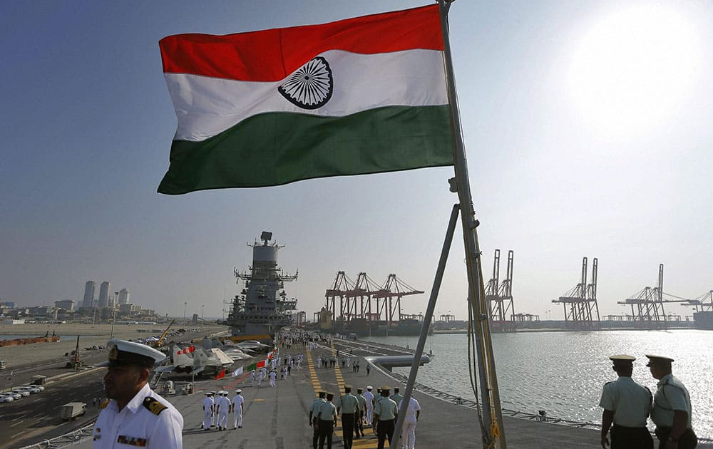 Sri Lanka security forces personnel walk on the landing deck of the Indias naval aircraft carrier INS Vikramaditya, which is on a goodwill visit to Colombo.