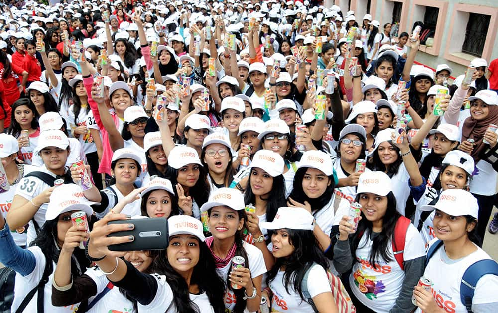 Around 900 students of Mount Carmel College take part in Most Drink Cans Opened Simultaneously, an attempt for Guinness World Records, in Bengaluru.