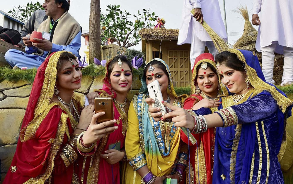 Jammu and Kashmir artists take selfie in front of their tableau for the Republic Day parade during a press preview in New Delhi.