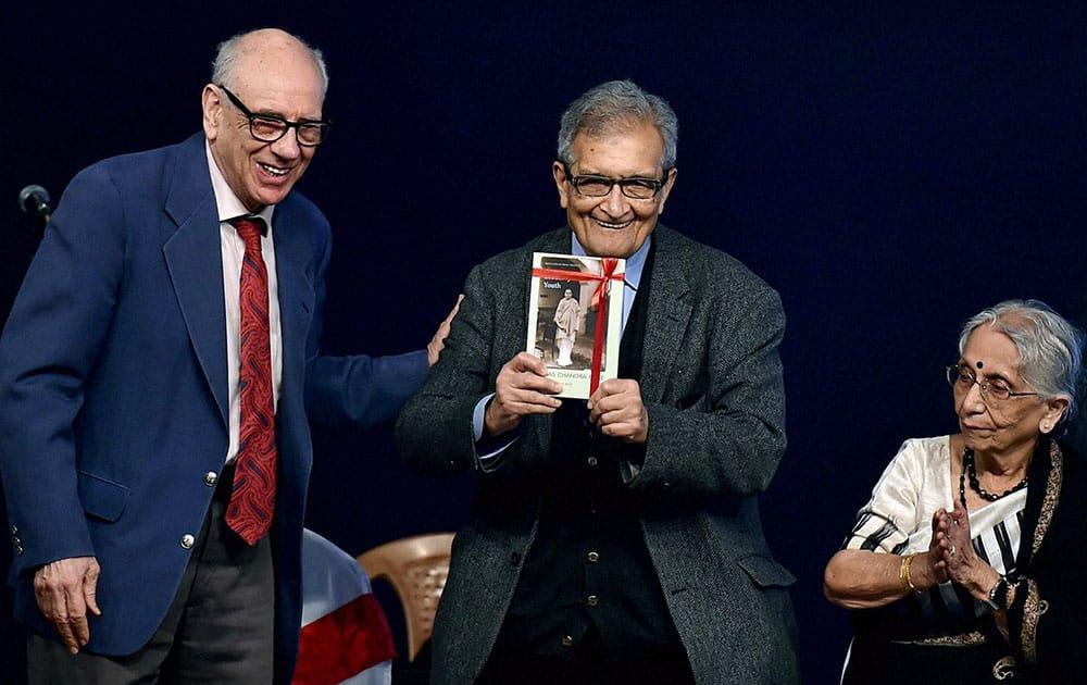 Nobel Laureate Amartya Sen releases a book on Subhash Chandra Bose as Leonard A Gordon (L), Professor of City University, New York and Krishna Bose, the niece of Netaji look on during a programme at Netaji Bhawan in Kolkata on Saturday to observe 119th birth anniversary of the great freedom-fighter.