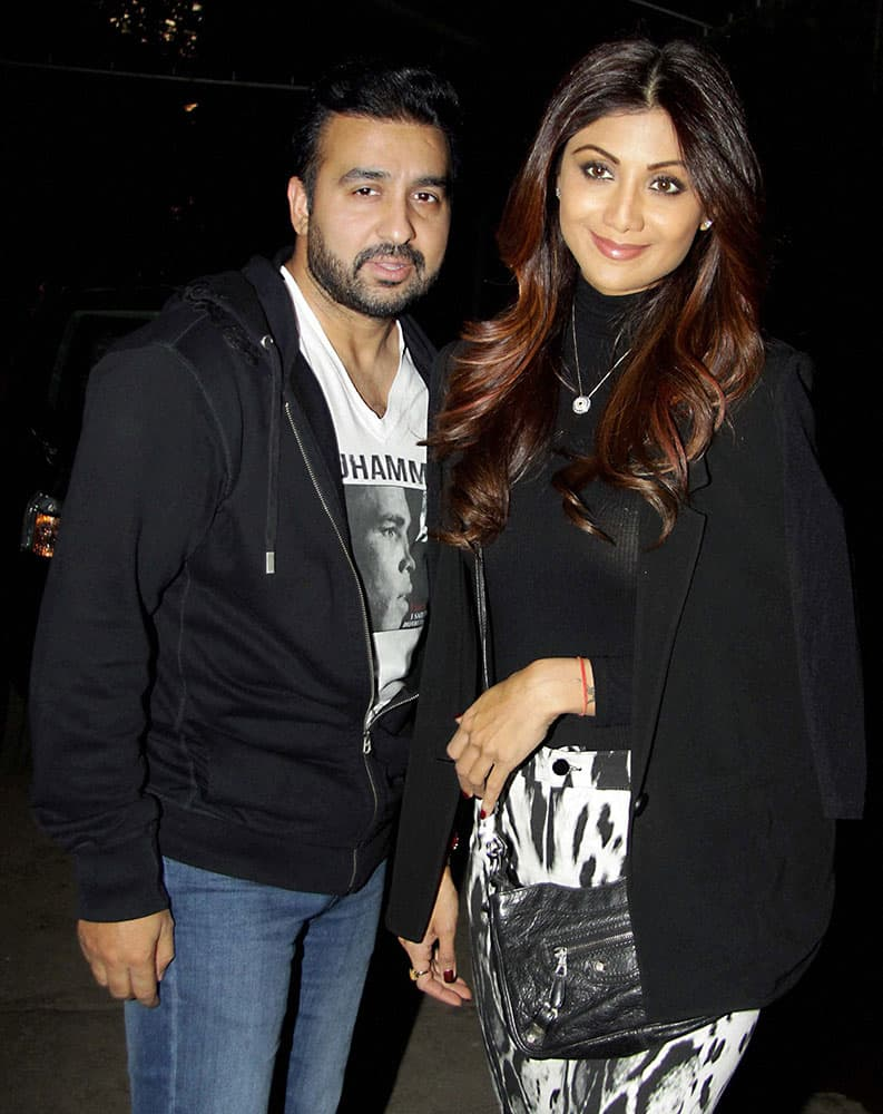 Bollywood actor Shilpa Shetty with her husband Raj Kundra at the screening of film Saala Khadoos in Mumbai.